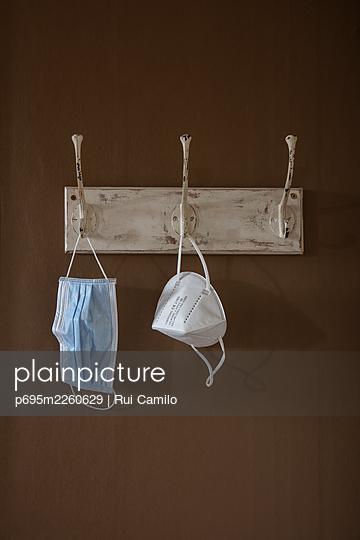 Masks on a coat hanger - p695m2260629 by Rui Camilo