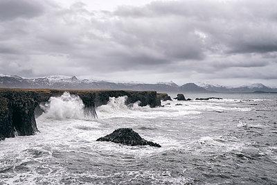 Ocean waves splashing on cliffs, Hellissandur, Snaellsnes peninsula, Iceland - p555m1491152 by Patrick Lienin