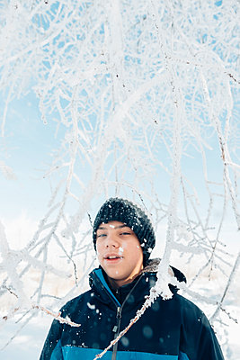 Teenager Portrait in Snow - p1262m1200658 by Maryanne Gobble