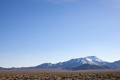 Snow Covered Mountain At The Edge Of The Desert - p1291m1548126 by Marcus Bastel
