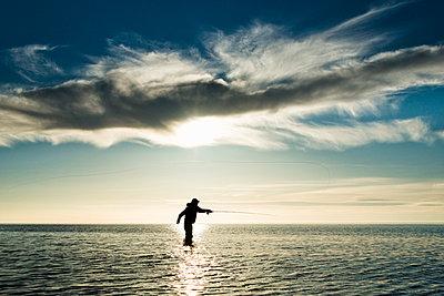 Man fishing at sea, Gotland, Sweden - p575m857829 by Hans Berggren
