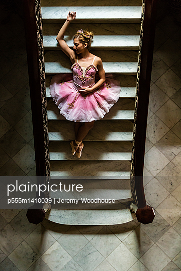 Hispanic ballet dancer posing on staircase