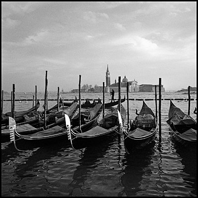 Gondolas in Canal with Saint Mark's Campanile and Basilica in Background, Venice, Italy - p694m910820 by Kurt Jordan