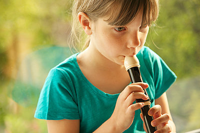 Girl Playing Recorder - p669m1038788 by Jutta Klee photography