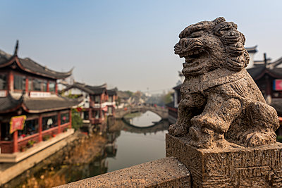 Lion sculpture on one of Qibao Old Town bridges, Minhang District; Shanghai, China - p442m2019636 by Dosfotos