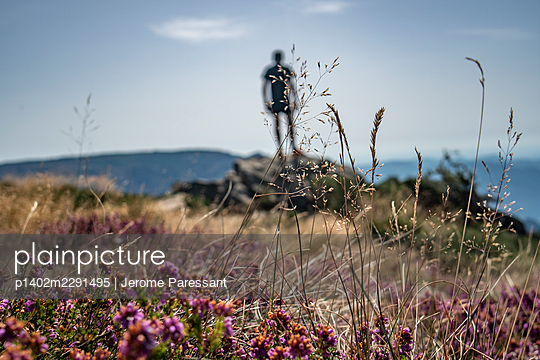 Man standing on a rock - p1402m2291495 by Jerome Paressant