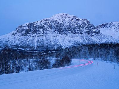 Snowy road  - p1250m2125590 by werner bartsch