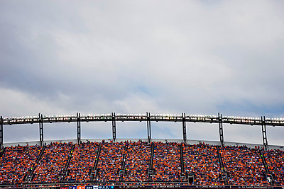 Stadium lights and nosebleed seats at Sports Authority Field at Mile High (also known as Mile High Stadium) - p343m1217899 by Leslie Parrott