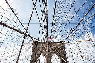 Brooklyn Bridge with American flag - p1057m1466847 by Stephen Shepherd