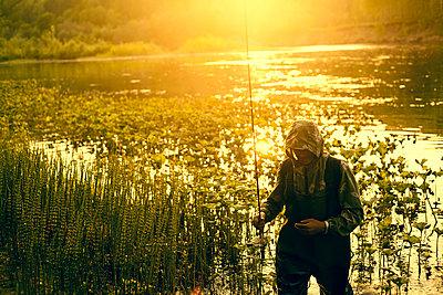 Mari fisherman carrying fishing rod at lake - p555m1415810 by Aliyev Alexei Sergeevich