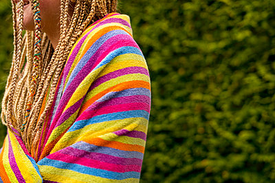 Young woman with dreadlocks wrapped in towel  - p1508m2099874 by Mona Alikhah