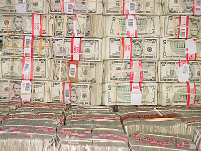 Bundles of Five Dollar Bills - p555m1459628 by Spaces Images