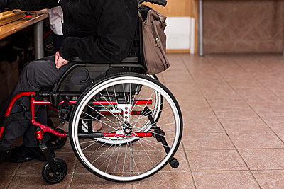 Mature man with disability sitting on wheelchair - p300m2243083 by DREAMSTOCK1982