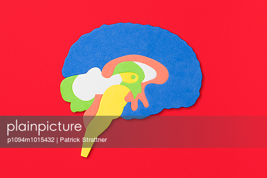 Cut out of human brain over red background - p1094m1015432 by Patrick Strattner