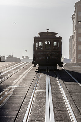 Tramway on city street at San Francisco during sunny day - p1166m1230537 by Cavan Images