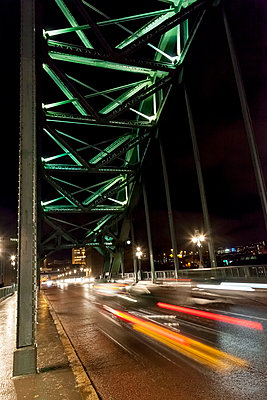 Cars travelling over a bridge at night - p1302m1196094 by Richard Nixon