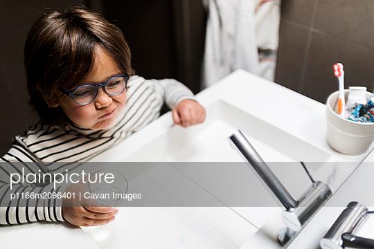 Boy on striped top Brushing His Teeth - p1166m2096401 by Cavan Images