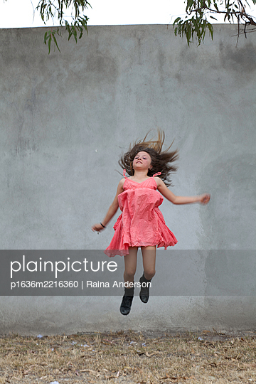 Girl Jumping - p1636m2216360 by Raina Anderson
