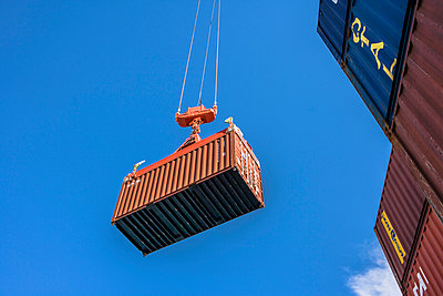 Container against blue sky - p1157m1041476 by Klaus Nather