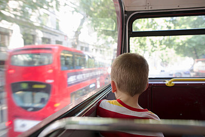 Young boy on double decker bus in London - p429m824251f by Gary John Norman