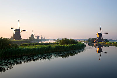 Wind mills at canal - p836m1492684 by Benjamin Rondel