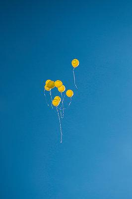 The few yellow balloons flying in the blue sky - p1412m1540129 by Svetlana Shemeleva