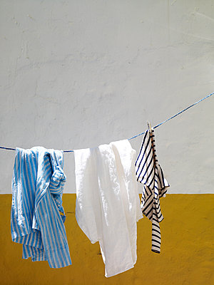 Clothing hangs on courtyard washing line, Spain - p349m2167734 by Polly Wreford