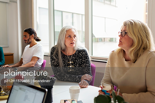 Three people at business meeting - p312m1570466 by Scandinav