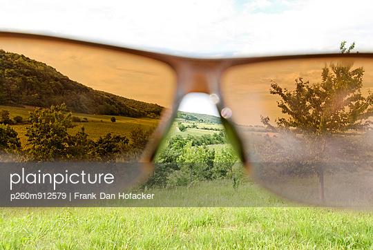 Through glasses - p260m912579 by Frank Dan Hofacker