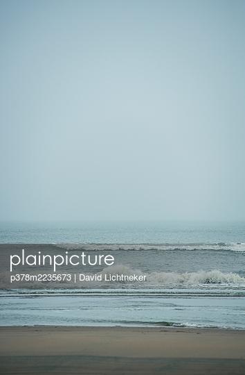 Sea lapping onto a beach - p378m2235673 by David Lichtneker