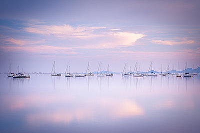 Ships reflections in Mar Menor . Long exposure shot in blue hour - p1166m2078420 by Cavan Images