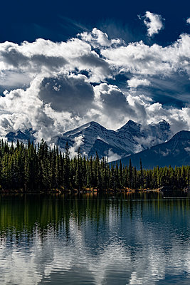 Dramatic clouds at Herbert Lake in Canada - p1455m2092367 by Ingmar Wein