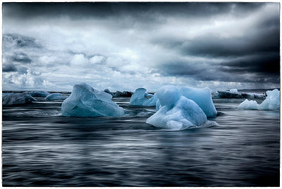 Drift ice and thunderclouds  - p1154m1110135 by Tom Hogan