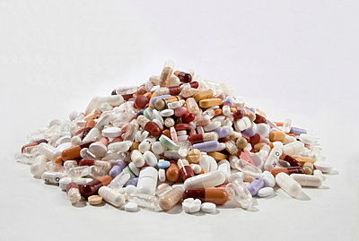 A pile of tablets, pills, and capsules - p30120563f by Larry Washburn