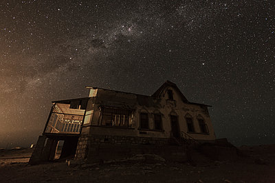 The Milky way above an abandoned house; Kolmanskop, Namibia - p442m1086793 by Robert Postma
