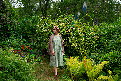 Young woman in her garden - p1646m2260617 by Slava Chistyakov