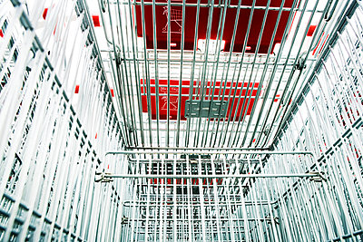 Shopping carts in a parking lot - p1084m1036783 by GUSK