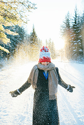 Smiling woman at winter - p312m1103673f by Anna Rostrom