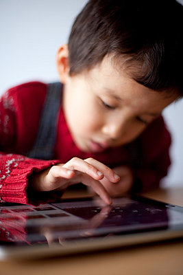 Child touching a tablet computer - p4451166 by Marie Docher