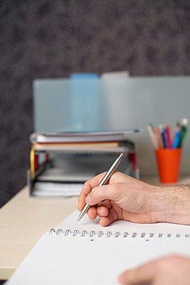 Writing businessman - p4733878f by Stock4B