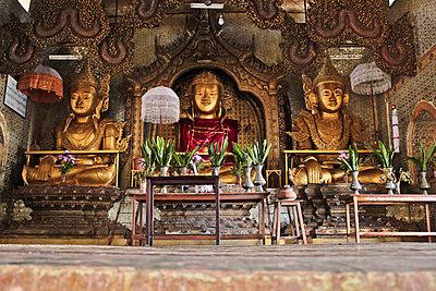 A Buddhist shrine with three golden Buddhas, Inle Lake, Burma - p301m714176f by Peter Erlemann
