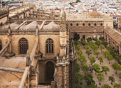 View of Seville gothic cathedral with inner courtyard from tower; Seville, Andalusia, Spain - p442m824078 by Perry Mastrovito