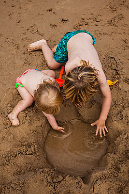 High Angle View of Two Young Children Playing in Sand at Beach - p694m1221884 by Julio Calvo