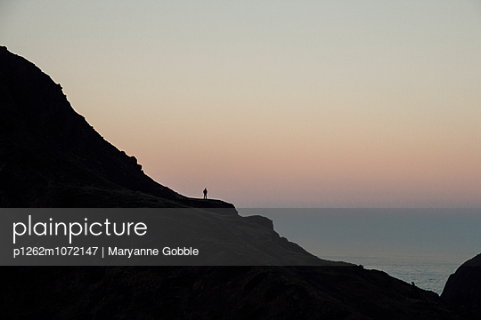 Lone Man at Sunset, Oregon Coast, Pacific Northwest - p1262m1072147 by Maryanne Gobble