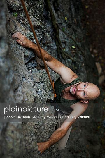 Rock climber climbing rock wall