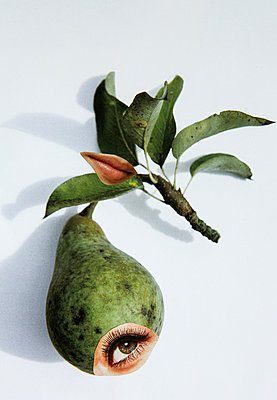 Pear with human eye and mouth - p1017m2203653 by Roberto Manzotti