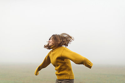 woman standing by forest in foggy weather - p1166m2151793 by Cavan Images