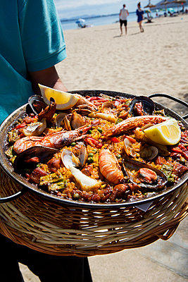 Seafood paella on beach - p312m1556876 by Lena Granefelt