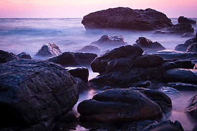 Rocks on shore at sunset - p1273m1496181 by melanka