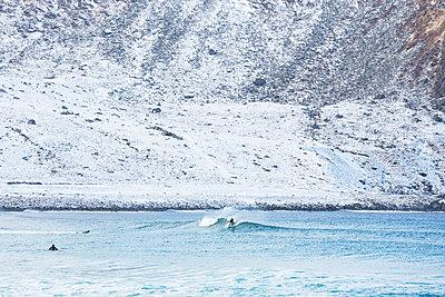 Surfer in Lofoten, Norway - p352m1536567 by Calle Artmark